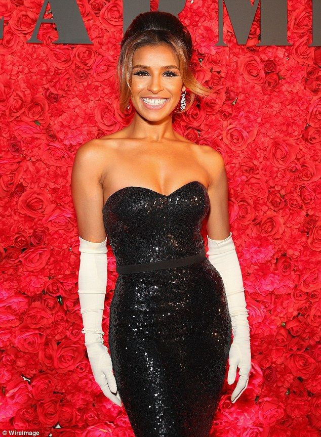 Melody Thornton sizzles in strapless sequinned gown and opera gloves as she…