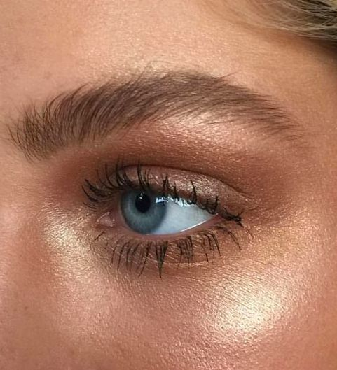 Dewy makeup and shimmer eyebrows and eyeshadow.