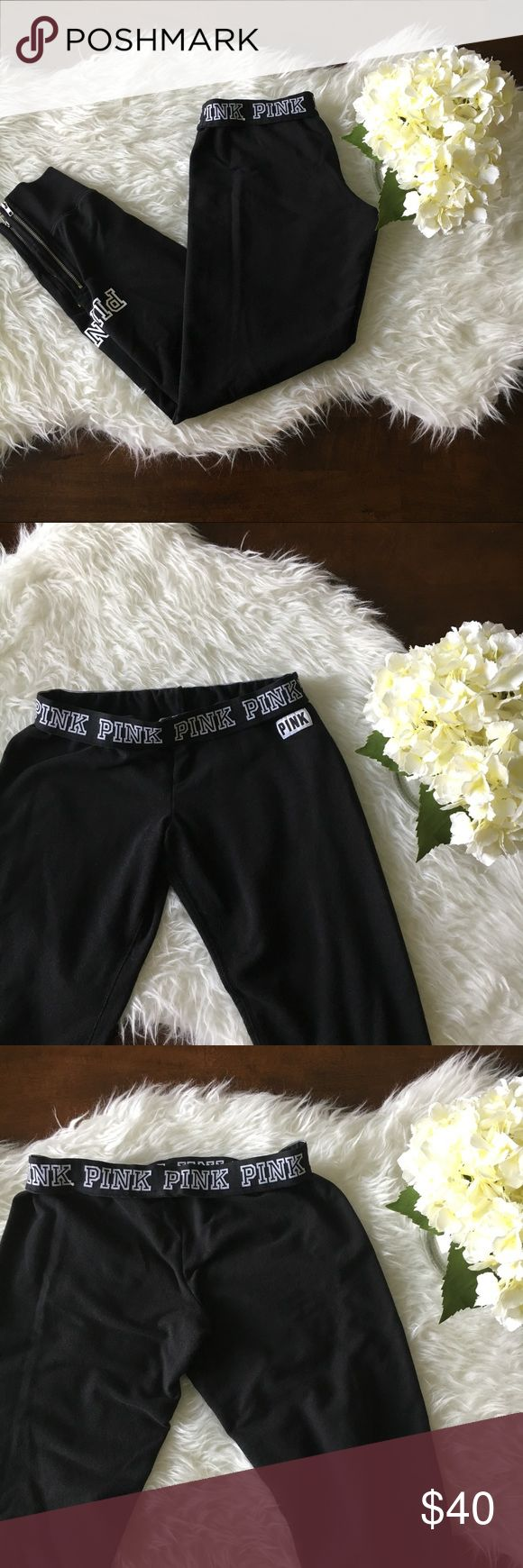 """PINK VS Black Joggers with Zipper Detail Excellent used condition. PINK Victoria's Secret soft and cozy black joggers with PINK logo in white and zipper detail to ankles. Approx measurements: inseam: 27"""". No tears, holes, or stains. Smoke free home. No trades please. PINK Victoria's Secret Pants Track Pants & Joggers"""