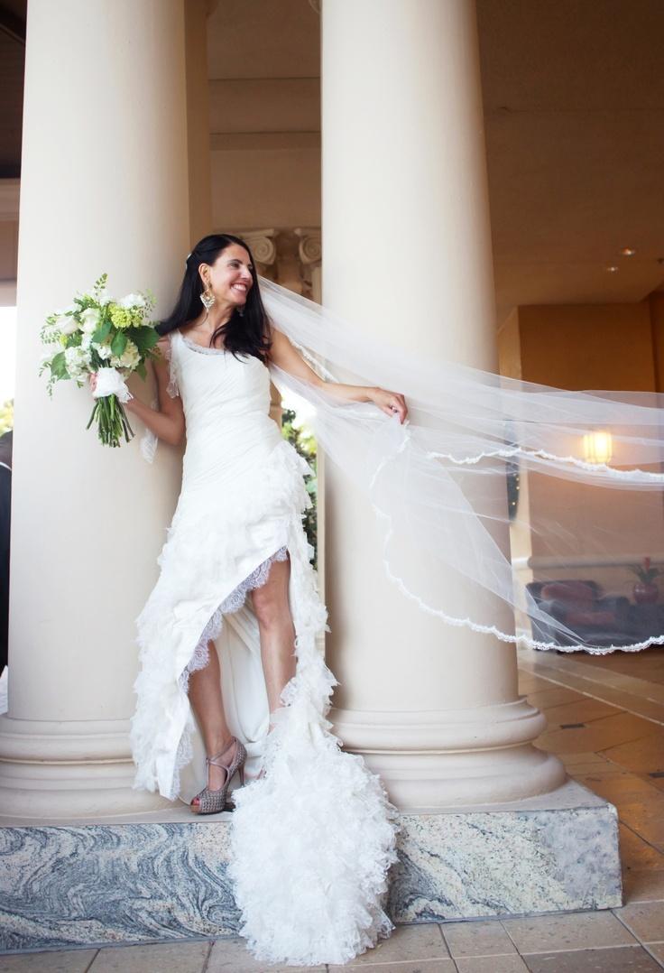 Christina McCaffrey's dress was made using fabrics selected by David in Paris, including French Chantilly lace, silk satin chiffon and charmeuse. (Photo: Kathi Robertson Wedding)