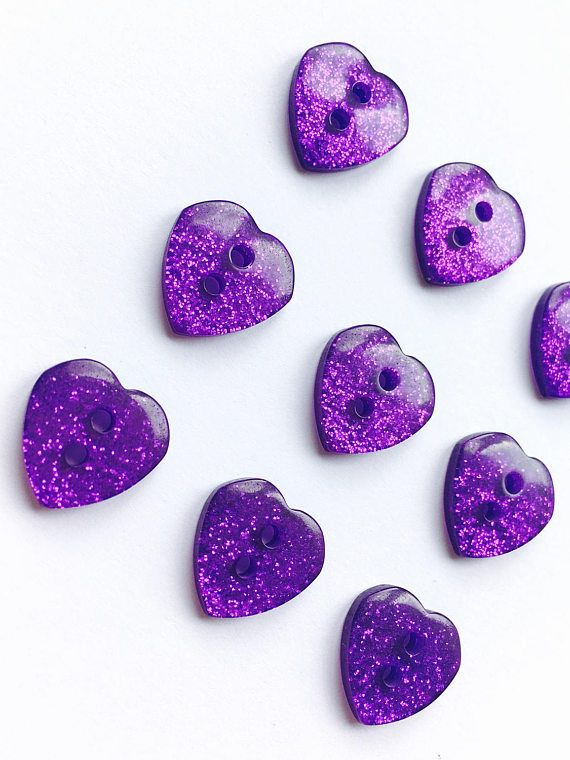 ☆Purple Heart Glitter Buttons ☆  ☆ Size Approx 13mm (0.53) ☆  These sparkly buttons are great for sewing, card making, scrapbooking and lots more!  These two hole buttons are made of plastic.  ☆ These buttons are purple coloured with glitter through them. ☆  To view more glitter buttons, follow the link https://www.etsy.com/uk/shop/SarahsPrettyPlaques?ref=hdr_shop_menu&search_query=glitter+buttons  ☆ Important Information ☆ Colours may vary slightly depe...