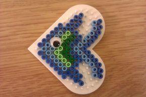 Simple Perler Bead fish design.  Love the googly eye.