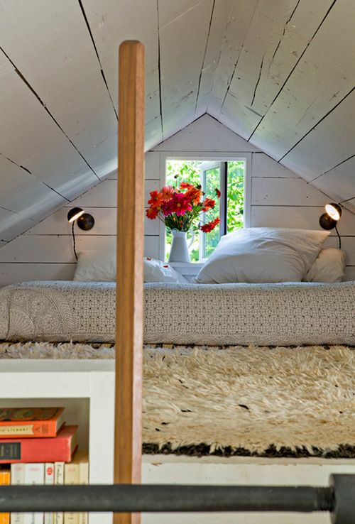 A tiny house in Portland, OR. Super cute loft arrangement. The whiteONwhiteONwhite is so nice because the textures are played up and varied. Makes those fresh flowers just POP!