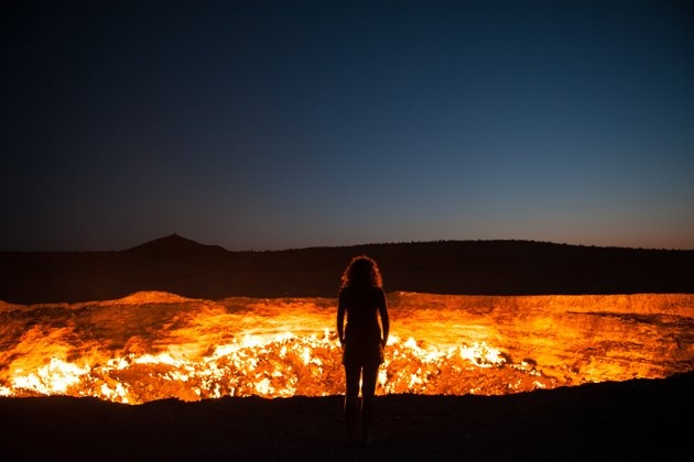 Door to Hell Standing at the edge of the Darvaza Crater in Turkmenistan.  Known as the Door to Hell,  this flaming crater has been burning for decades, fueled by the rich natural gas reserves found below the surface. (Photo and caption by Priscilla Locke)