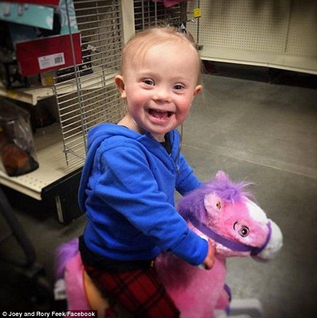 '...born to ride': Joey and Rory Feek shared an uplifting snap of their little girl Indiana playing with a pink toy horse on Friday Jan 29, 2016