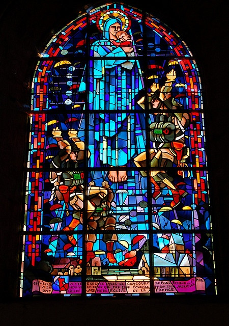 Window in a church in Ste-Mere-Eglise, Normandy, France, showing the paratroopers who liberated the town on D-Day