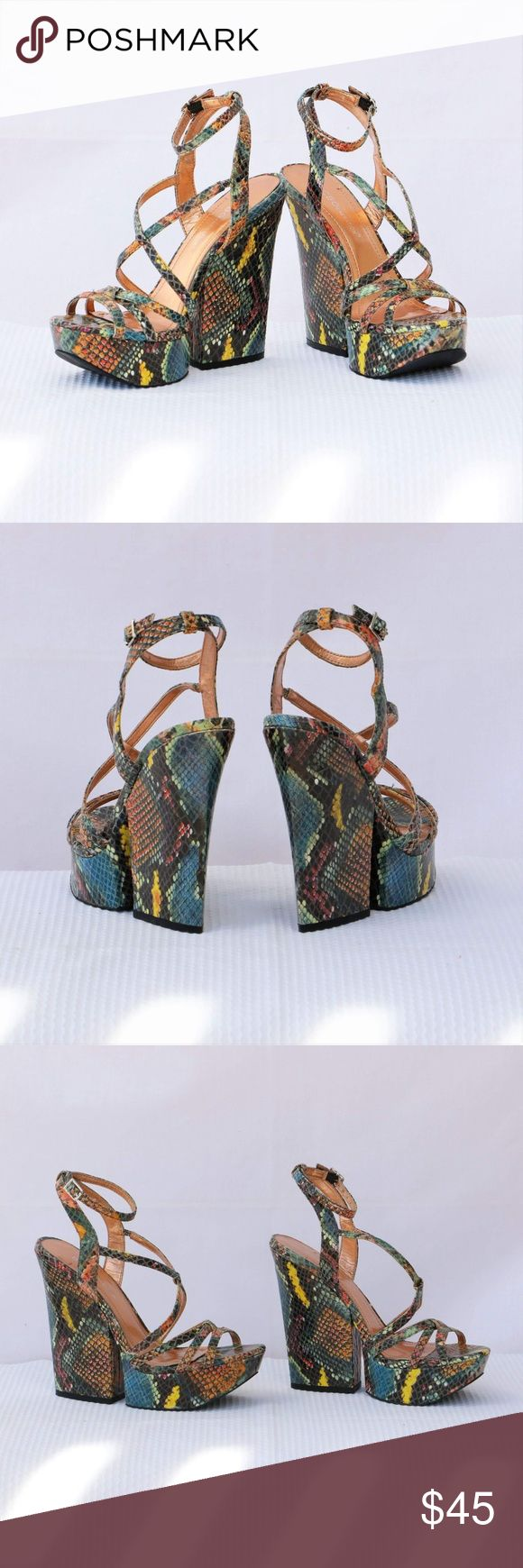 """BCBG Multi-Colored Wedge Strappy Heels: size 5.5M BCBGeneration Multi-colored Snake print Platform/Wedge Strappy Heels in size 5.5M.  Very cute heels with adjustable ankle strap and small elastic band for comfort.  This is worn item as shown in photos and without original box item. Heel height: 5 1/4"""" Platform height: 1 1/2 BCBGeneration Shoes Wedges"""