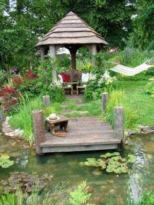 Backyard garden, stream, little dock, landscaping by Kim N Barry Manning