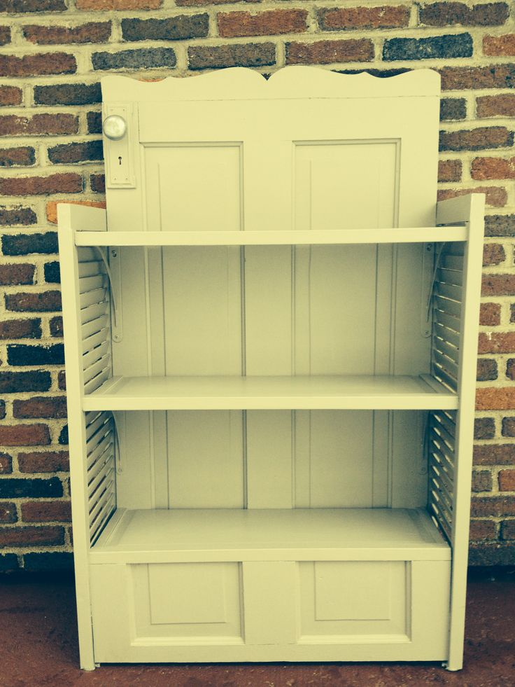 Old Door And Shutters Repurposed Into A Book Shelf By