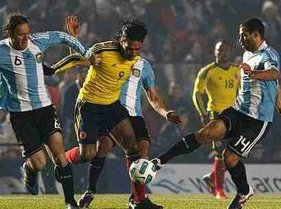 Argentina 0 Colombia 0 in 2011 in Santa Fe. Radamel Falcao runs between 2 Argentina players in Group A at Copa America.