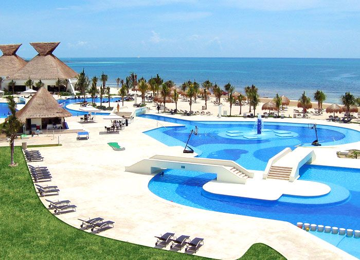 Cancun Vacations - Blue Bay Grand Esmeralda Resort and Spa - All-Inclusive - Upscale, modern all-inclusive resort featuring 9 restaurants, 3 pools, a world-class gym, and 1 of the largest spa facilities in the Riviera Maya.