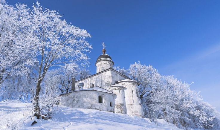 Orthodox church near by river. Pskov. Winter. Russia. by MayaAfzaal