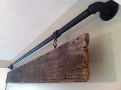 galvanized pipe and old barn wood -- with your last name or a quote written on the wood
