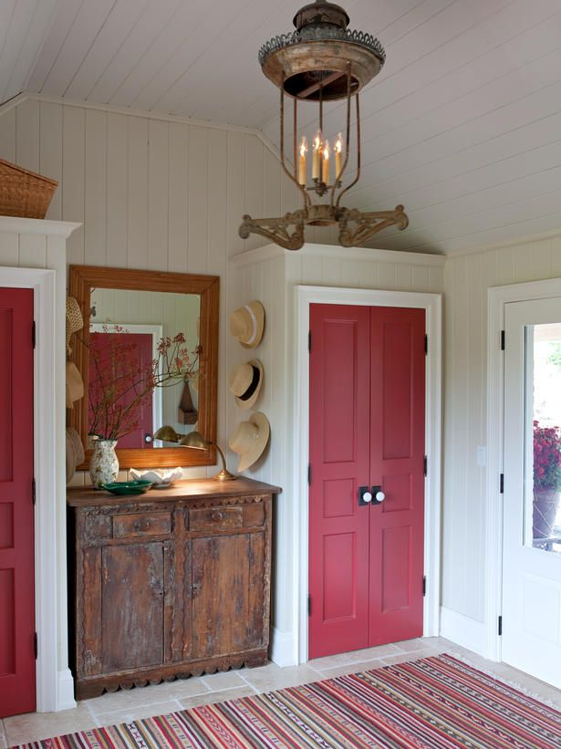 Muted hues are paired with pops of red, black or white accents in country style. Look for accessories with a handmade rustic quality, including pottery and baskets. Wood also plays a prevalent role in country design. Design by Sarah Richardson.: Red Doors, Ideas, Farms House, Closets Doors, Mudroom, Sarah Richardson Farmhouse, Mud Room, Sarah House, Sarahs House
