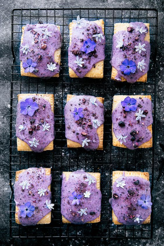 Celebrate spring (and breakfast time) with homemade lemon curd pop-tarts topped with a natural blueberry icing and edible flowers!: