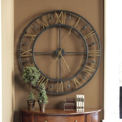 Chateau Betton Clock | Home Accessories | Ballard Designs - Though grand in scale, the airy openwork frame of our Chateau Betton Clock won't overwhelm your room and let's your wall color become part of the design. Each Roman numeral and spear detail is individually welded by hand, giving the entire piece an impressive sculptural presence.