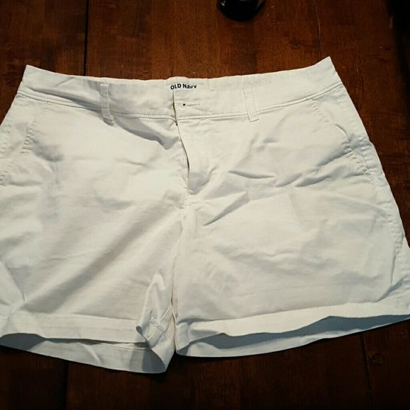 White Old Navy shorts Old Navy shorts in near perfect condition. One tiny stain on the back, the size of a pin prick (Shown in 3rd pic). 4 inch inseam. Old Navy Shorts