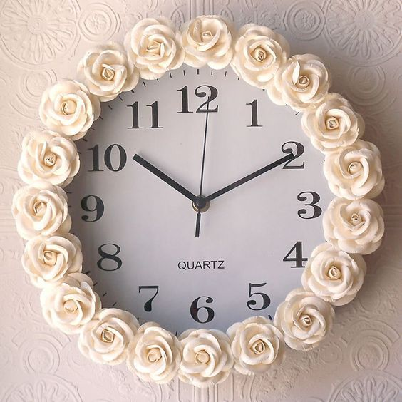 Cream Rose Wall Clock. or you can just DIY and buy little rosettes at a craft store, a cheap clock, and hot glue the little rosettes to the clock!! genius!!