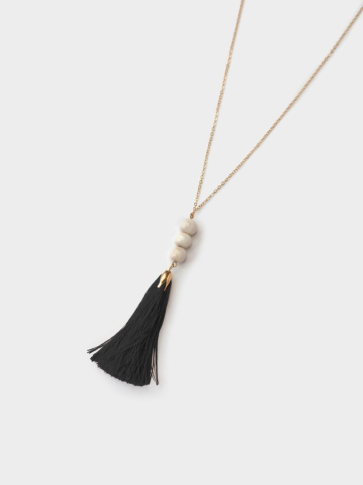 "- This necklace features a mixture of white bone beads + a rose gold tassel for a necklace that will go with any outfit! - It hangs a total of 17"", including the 3"" tassel"