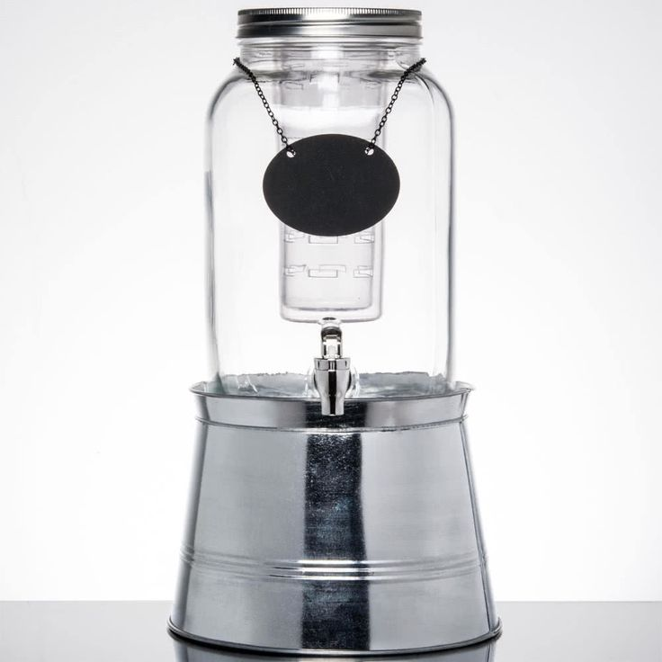 Great for restaurants, cafes, coffee shops, or hotels, this Core 2 gallon mason jar glass beverage dispenser with chalkboard sign and metal stand is a stylish way to serve your signature, chilled beverages! Its attractive, vintage jar design is sure to enhance your beverage service and add a rustic touch to your venue. While its ample capacity helps to minimize refills, its crystal-clear construction expertly showcases colorful drinks for an eye-catching appearance. It also comes with a…
