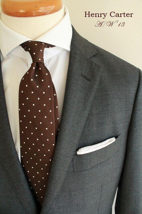 Dark grey suit, white shirt, brown tie with white polka dots