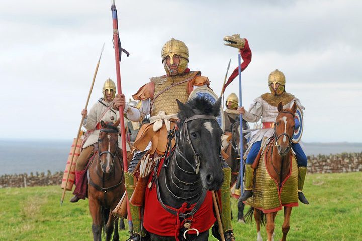 "Romano-British Cavalry.A  representation  of  Arthur  and  his  Late  Roman/Romano-British  heavy  cavalry  (""Knights"")  by  the  British  Historical  Association Comitatus. One possible inspiration for legends of King Arthur. Note  the  'Draconarius' standard-bearer,  bearing the  Sarmatian  standard of  the  Dragon."