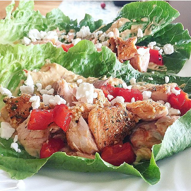 This deliciousness was #dinner tonight!!! Baked Salmon and romaine lettuce wraps!! Bake your salmon and while its cooling get a couple romaine leaves, smear with red pepper hummus then add your salmon, roasted red peppers and feta cheese then wrap them up OR eat like tacos! Delicious! Wish I had had some avocado handy…