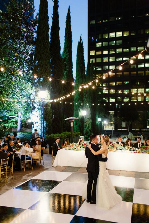 city rooftop wedding recetpion with twinkle lights - photo by The Melideos