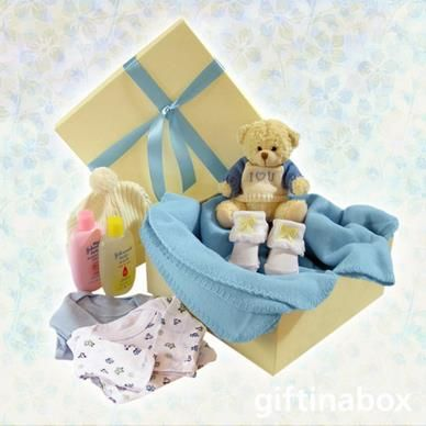 Welcome to the new baby boy of the family. Give him lots of love with these beautiful products and his own snuggly blue cuddle blanket. All goods are lovingly presented in a cream gift hamper box decorated with blue ribbons and tissue paper.   Cuddly teddy bear Sock booties 2 cotton vests Baby leggings Baby beanie Baby lotion Baby powder Baby soap Blue snuggle blanket Ferrero Rocher chocolate trio for mom