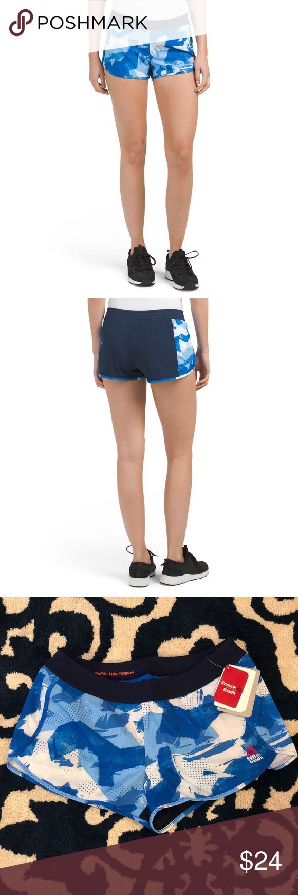 "Reebook Printed Crossfit Shorts Brand new with tags. The shorts have a blue and white pattern. The size is small.  These shorts feature an elastic waistband with interior drawstring, built-in mesh lining, and a rear zipper pocket. The shorts also feature an anti-microbial fabric for odor control and Reebok's ""Speedwick"" technology that wicks moisture from your skin to keep you dry and comfy. The shorts low-rise.   Width: 14 inches across the waist Length: 11 inches Reebok Shorts"