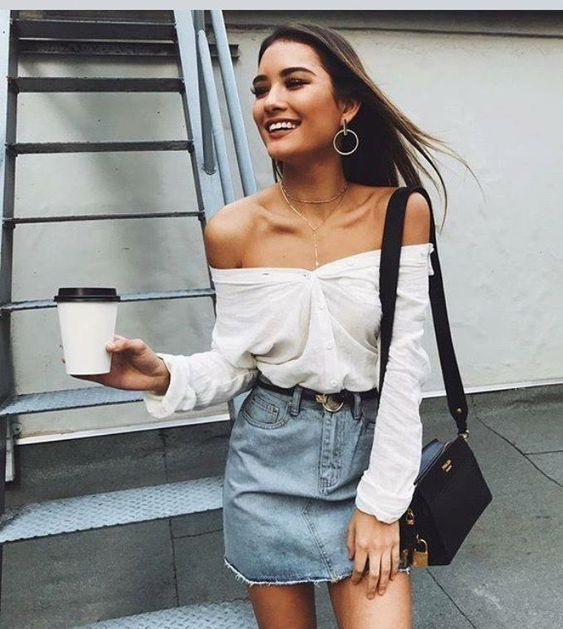 3ca5dbab932 White off the shoulder top with denim mini skirt and chic black handbag.