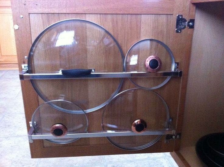 Install a towel rack on a cabinet door in your kitchen and store pot lids in them.