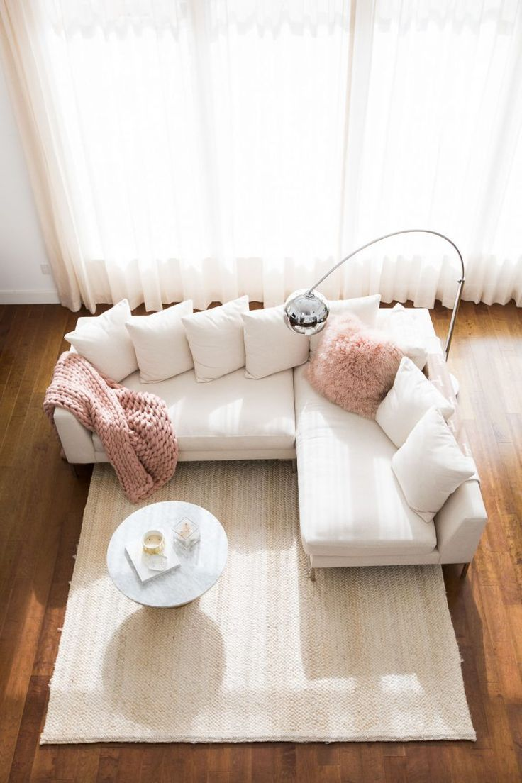 Pink living rooms ideas that are not overbearing - Marianna Hewitt Home Tour Living Room Sectional Couch Chunky Knit Blanket Marble