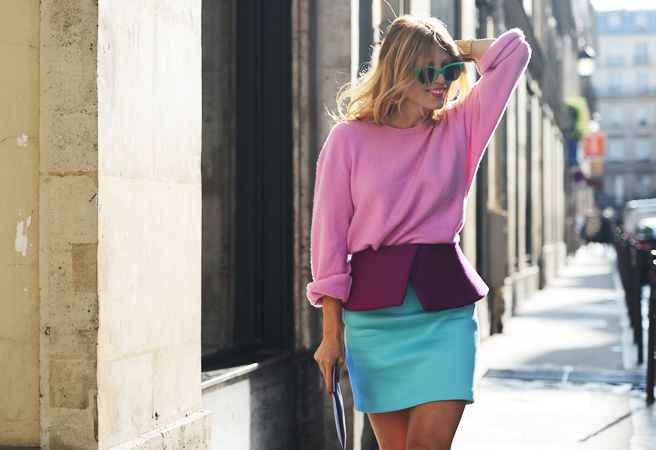 Model street style rocking a pink sweater, purple peplum and turquoise skirt.