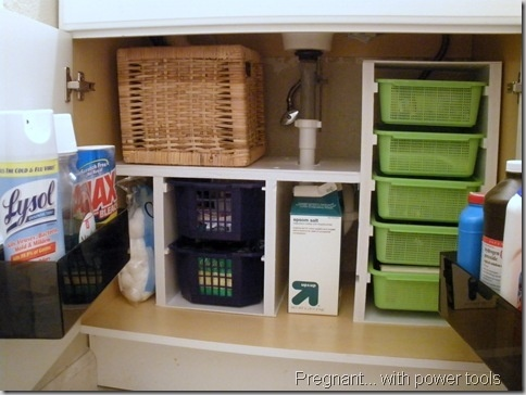 Under the sink storage for the bathroom.   Made with some scrap lumber and dollar store plastic bins.