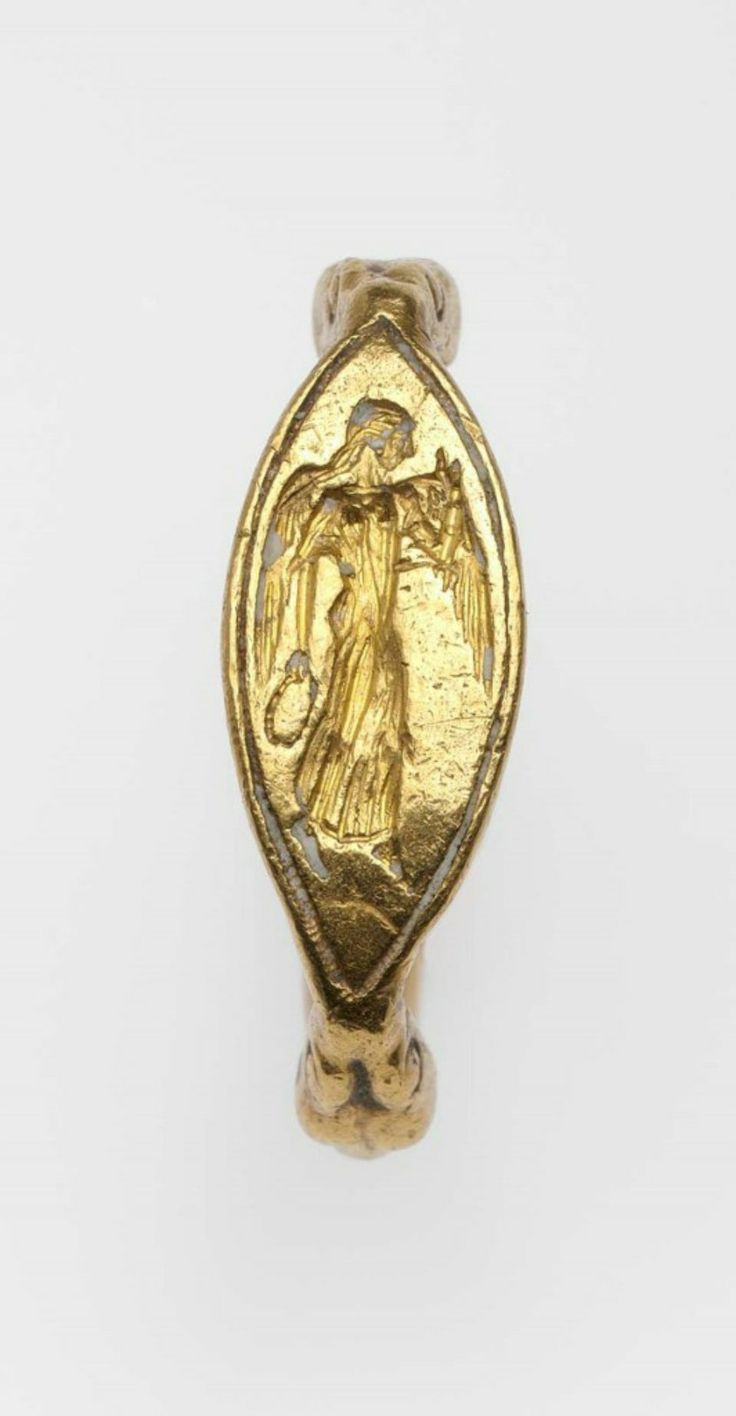 Ring with Nike holding a wreath, Greek, Late Archaic or Early Classical Period, 500–450 B.C. Length (of bezel): 1.5 cm (9/16 in.); Diameter (of hoop): 2 cm (13/16 in.), Gold