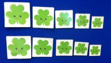 five green shamrocks