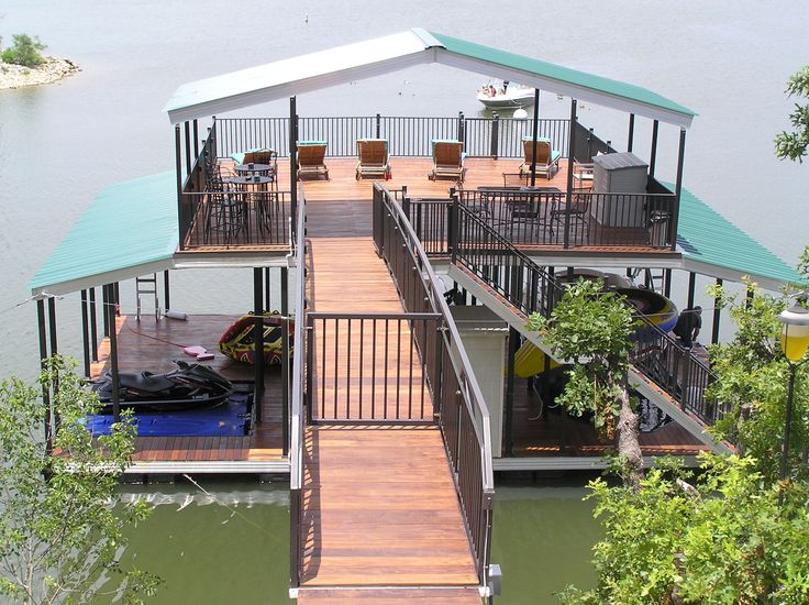 Wahoo custom multi-slip aluminum floating dock with sun deck and sheet metal A-frame gables ...