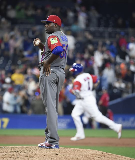 World Baseball Classic: Dominican Republic vs. Puerto Rico  -    March 15, 2017   -          Hector Neris #50 of the Dominican Republic stands on the mound after giving up a solo home run to Yadier Molina #4 of Puerto Rico during the sixth inning of the World Baseball Classic Pool F Game One between the Dominican Republic and Puerto Rico at PETCO Park on March 14, 2017 in San Diego, California.