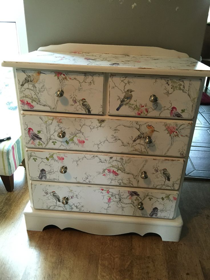 Old pine chest of drawers painted in off white egg shell paint and then sides top and drawer fronts covered in wall paper...