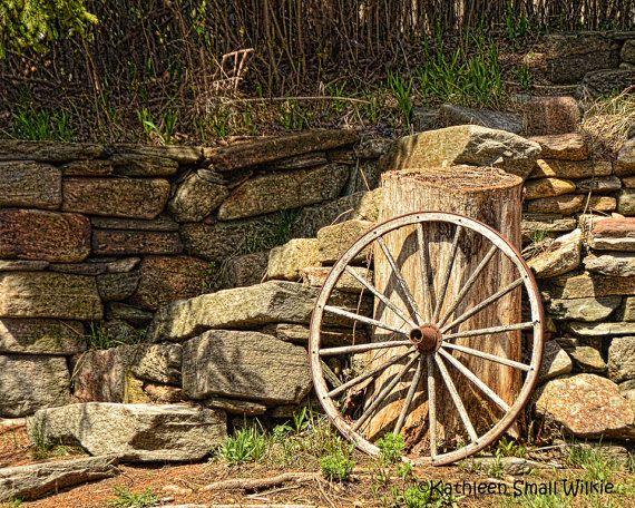antique wagon wheel,rustic wagon wheel,old wagon wheel,wood wagon wheel,stone wall,unique gift,gift idea,wall art,home decor,Etsy find