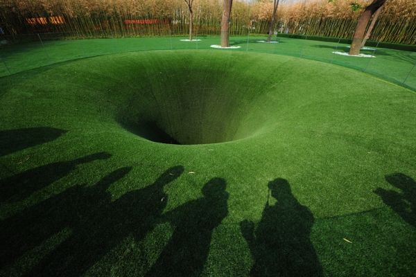 Digging a Hole to the Other Side of the World - Remember as a child, plopped down in a sandbox with a few trucks and a shovel, when you suddenly struck on the brilliant idea of digging straight down through the Earth, all the way to China? What would you find there? Berlin-based firm Topotek1 keeps that dream alive with their latest installation for the 2011 Xi'an International Horticultural Exposition.