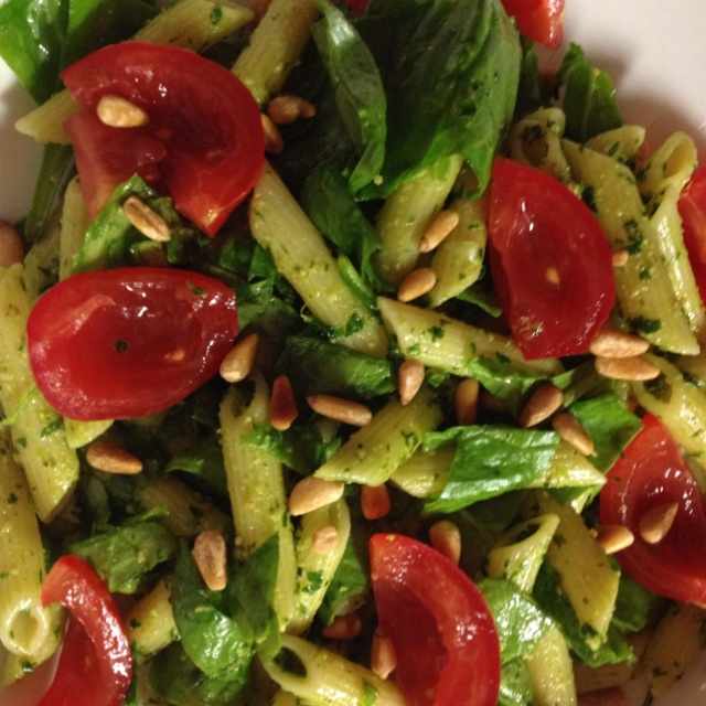 Penne, spinach and tomato salad with basil and parsley pesto.