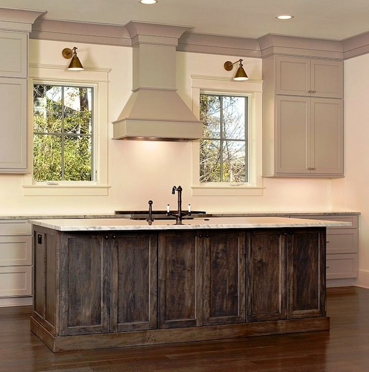 Stunning Kitchen Featuring Taupe Cabinets With Matching Taupe Crown Molding  And Granite Countertops. Rustic Dark Stained Kitchen Island And Sink With  ...