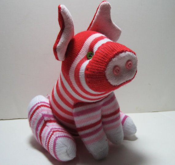 PEPPERMINT TWIST is a little piggie sock toy by garishrubbish, $28.00