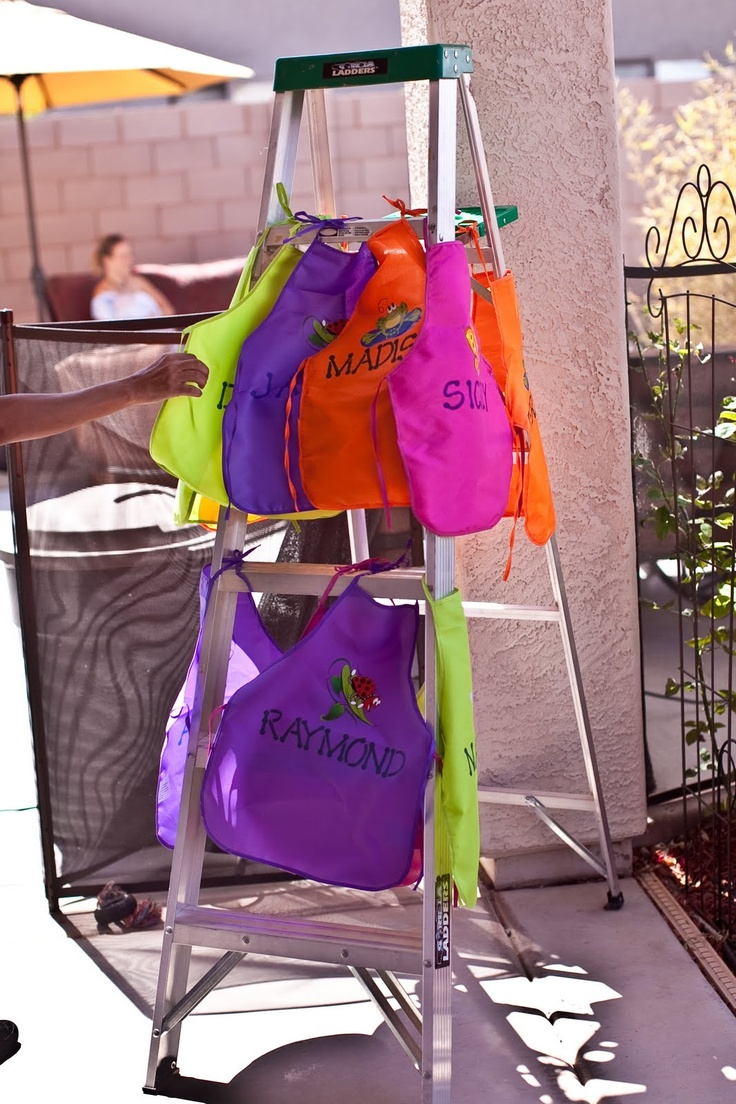 I LOVE THIS!!  These aprons are less than $1 ea on Amazon.  Hang apron favors for each kid on a ladder.