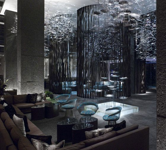 Contemporary design for W Hotel in Atlanta by Toronto design firm Burdifilek.  The Canadian design firm has created a very textural and colorful environment, blending hard edged surfaces with organic forms.  Strategic color accents complement the subtle shades of grey and earthtones - bringing a sense of luxury to the landscape.