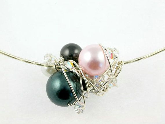Hey, I found this really awesome Etsy listing at https://www.etsy.com/se-en/listing/155327349/swarovski-pearl-ball-necklace-wire