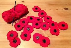 remembrance day crochet poppy brooches, free pattern, but you have to scroll way down the page to get it.