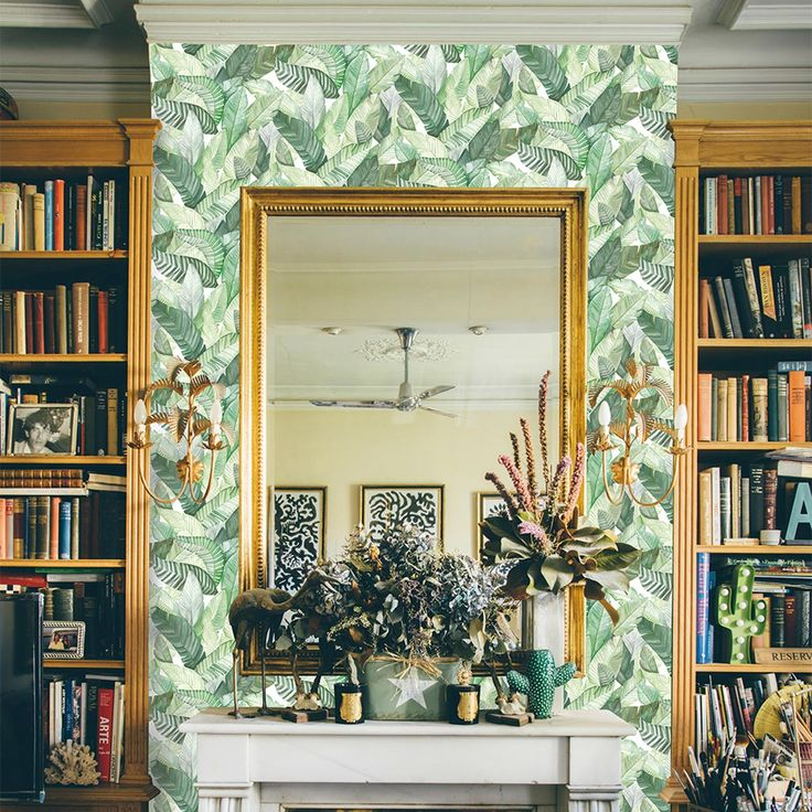 Green banana leaf wallpaper + antique brass mirror | #fireplace #mantel #livingroom #maximalism #tropical